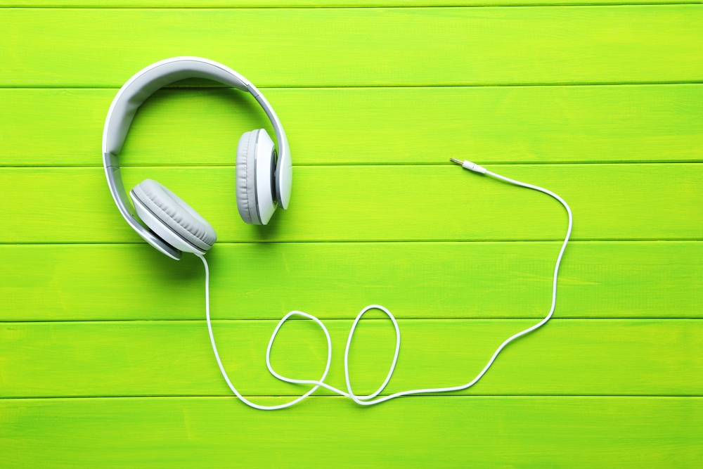 White-Headphones-on-Green-Background