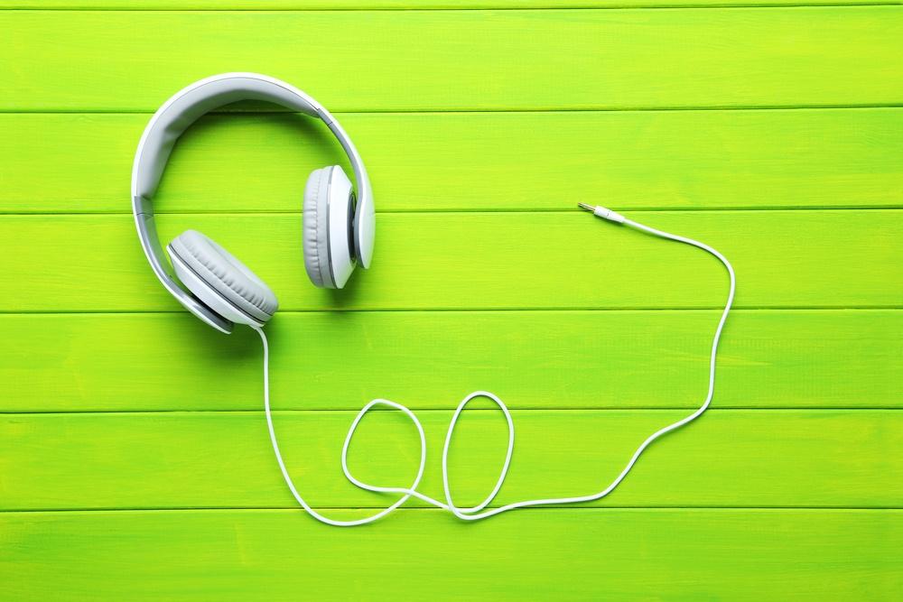 White-Headphones-on-Green-Background